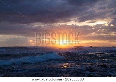 Sea scape waves sunset light glow and cloudy sky