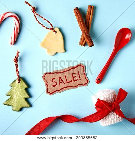 christmas sale. flaytlay with christmas simbols and handwritten text Sale