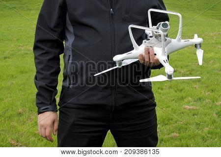 Person Prepares A Drone For A Flight