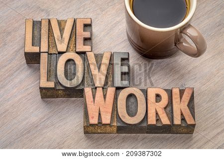 live, love, work word abstract in vintage letterpress wood type with a cup of coffee