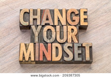 change your mindset - motivational text in vintage letterpress wood type printing blocks stained by color inks