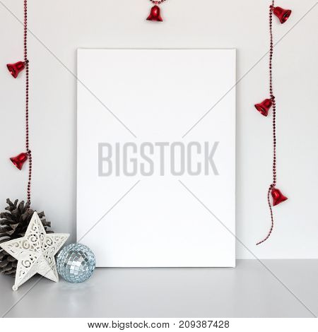 Mock-up poster. Blank canvas lean at white wall. Christmas and New Year decoration.