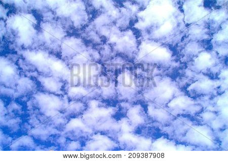 Fluffy clouds high in the sky outdoors in nature.