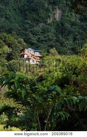 NEPAL. POKHARA - OKTOBER 28 2016 : Yoga retreat purna yoga in the green hills on the outskirts of Pokhara. Pokhara second most important and largest city of Nepal.