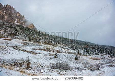 Dolomites. Giau Pass 2236 meters high covered with clouds. The first snow fell in October
