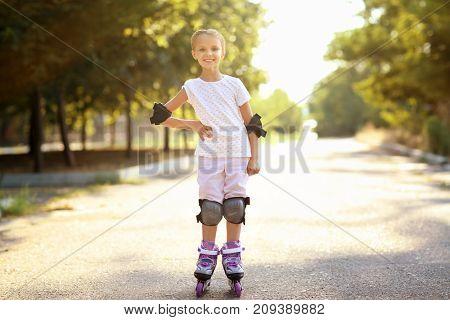 Cute girl rollerskating in park