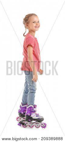 Cute girl on roller skates against white background