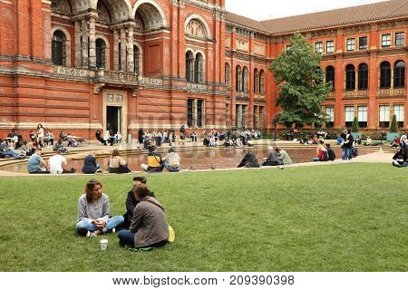 LONDON, UK - 24 SEPTEMBER, 2017: People spending their sunday afternoon in the courtyard at the Victoria and Albert Museum, London, UK, Europe