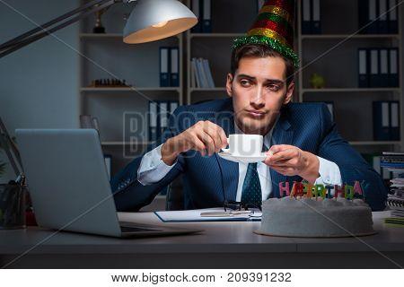 Man celebrating birthday in the office