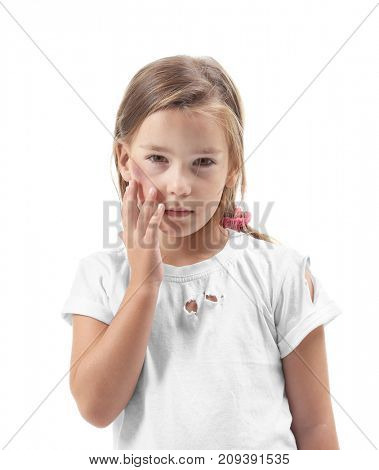 Little girl with bruise on white background. Domestic violence concept