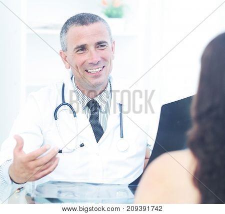 family doctor counsels the patient and discusses with her the re