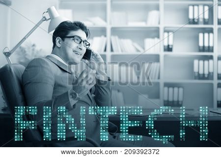 Businessman talking on smartphone in fintech concept