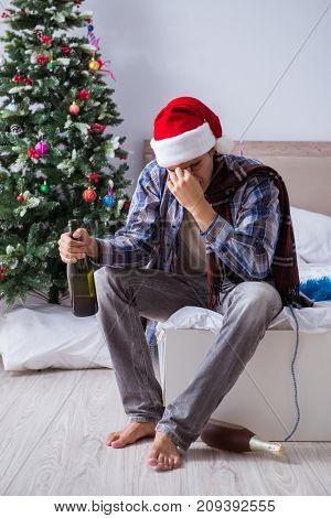 Man suffering hangover after christmas party