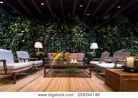 SAO PAULO BRAZIL - OCTOBER 07 2017: Horizontal picture of indoor room with nice furniture and wall with plants for a wedding party in the city of Sao Paulo Brazil.
