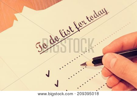 A Sheet Of Paper In Front Of A Man With The Words: To Do List For Today . Planning Of Affairs For Th