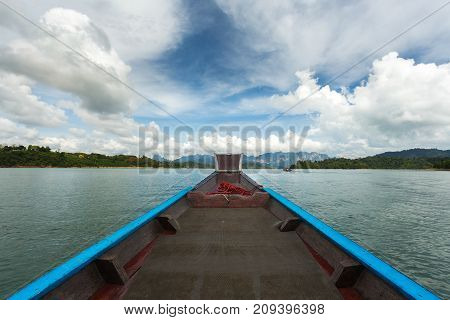 The Nose Of A Long-tailed Boat Against The Background Of The Karst Rocks Of Lake Cheo Lan