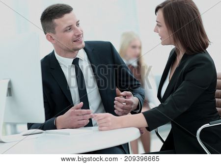 Business people at work. Two business people in formalwear discuss