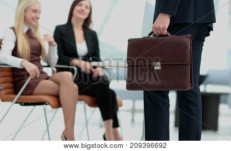 Portrait of business team smiling working at office