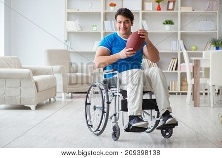 Young man american football player recovering on wheelchair