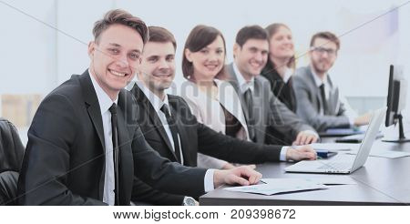 company's shareholders at a meeting at work, sitting at a table