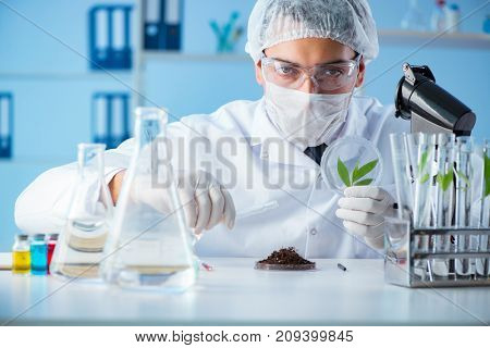 Male scientist researcher doing experiment in a laboratory
