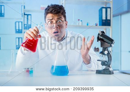 Funny mad chemist working in a laboratory