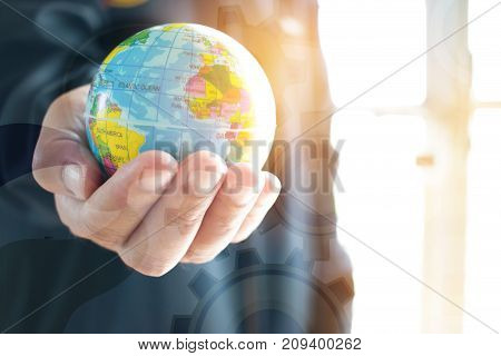 Businessman holding Earth globe model ball map in hands. Concept for global business communications politics or save world environmental for learning world wide in online market.