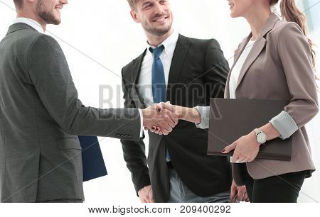 Handshake between business people in a modern office