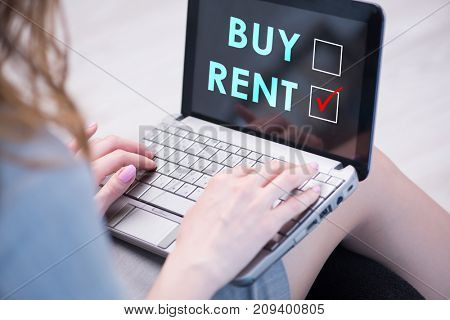 Businesswoman facing dilemma of buying versus renting