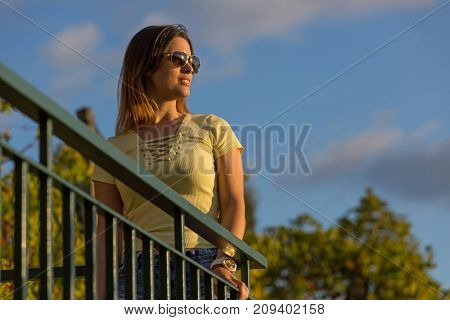 beautiful casual woman enjoying the sunset, outdoor
