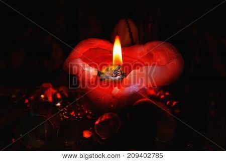 Close view of romantic red candle .