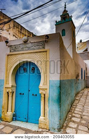 A street in Medina in Sousse, Tunisia. Magical space of medieval town with colorful walls and stone pavement.