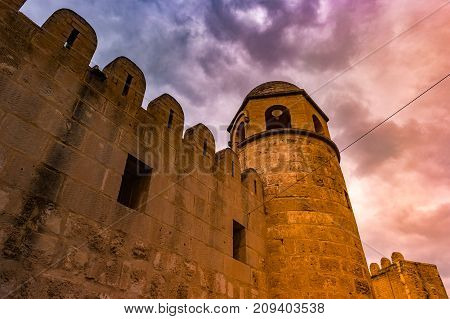 Photo of Mosque in Sousse. Medieval architecture of famous african city. Vivid picture of ancient religious building - one of the main attractions in Sousse, Tunisia.