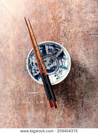 Wooden Chopsticks on a Ceramic Bowl