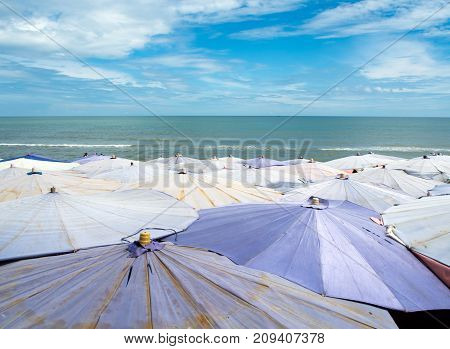 Large umbrella crowded along the beach in the beautyful sky day