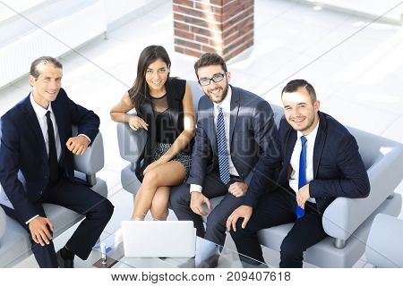 portrait of successful business team sitting in office lobby