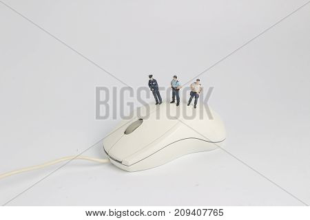 Police Stand On Computer Mouse. Computer Security