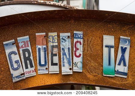January 1 2016 Gruene Texas: the name of the town spelled with cut up vehicle license plates