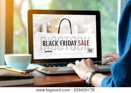 Woman hands typing laptop computer with www. on search bar over black Friday sale banner background Holiday shopping business and technology