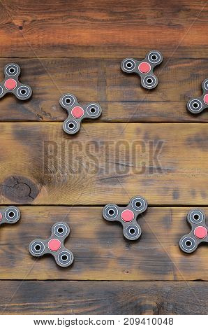 A Rare Handmade Wooden Fidget Spinners Lies On A Brown Wooden Background Surface. Trendy Stress Reli
