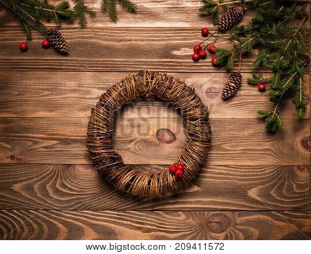Christmas wreath. Set to create a traditional Christmas wreath of fir branches berries on a dark wooden background. The festive concept. The view from the top