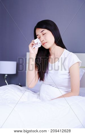 Woman Is Crying On Bed In Bedroom