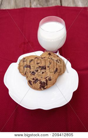 Chocolate Chip Cookies On A White Plate With Whole Milk