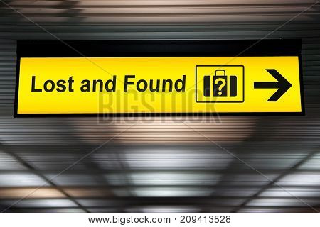 Lost and Found sign hanging from ceiling at the Airport