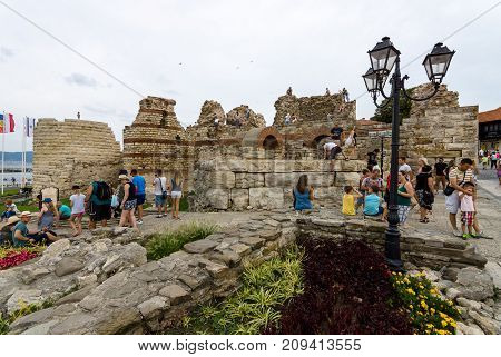 NESEBAR BULGARIA - AUGUST 21 2017: Ruins of an ancient fortress wall at the old town of Nesebar. Nesebar is an ancient city and one of the major seaside resorts on the Bulgarian Black Sea Coast.
