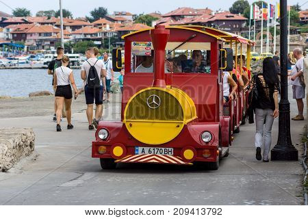 NESEBAR BULGARIA - AUGUST 21 2017: Stylized for the locomotive with the carriages a walking road train. Nesebar is an ancient city and one of the major seaside resorts on the Bulgarian Black Sea Coast.