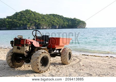 Engine modified adapted to a small truck on the beach in Thailand. poster