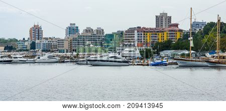 NESEBAR BULGARIA - AUGUST 21 2017: Marina for yachts and boats in the UNESCO World Heritage town of Nesebar. In the background modern houses of the new town.