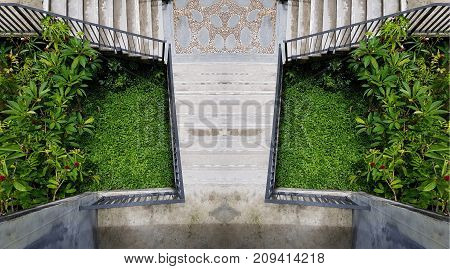 cement outdoor stairs into the green garden. modern stairway. symmetry staircase photo. outdoor exterior decoration design