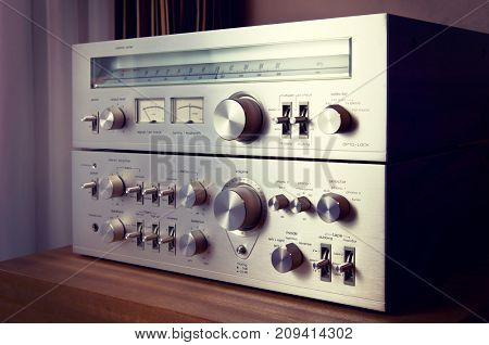 Vintage Stereo Amplifier Shiny Metal Front Panel Controls Side View